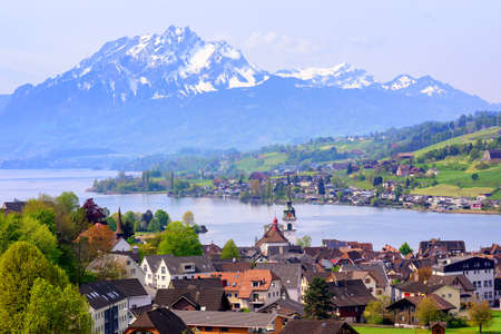 swiss alps: Kussnacht am Rigi old town with Pilatus mountain and Lake Lucerne in background, Switzerland