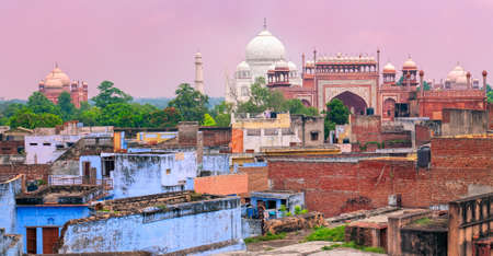 agra: Old town of Agra with Taj Mahal in background on sunset, Agra, India