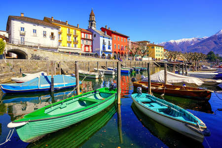 maggiore: Colorful boats in old town of Ascona on Lago Maggiore lake in the Alps mountain, Ticino, Switzerland Stock Photo
