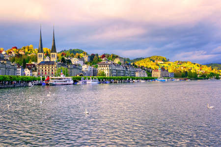 lucerne: Skyline of Lucerne town with towers of St. Leodegar church and luxury hotels on Lake Lucerne, Switzerland, on sunset Stock Photo