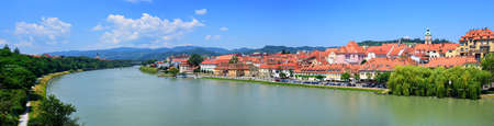 drava: Panoramic view of the red roofs old town of Maribor on Drava river, Slovenia