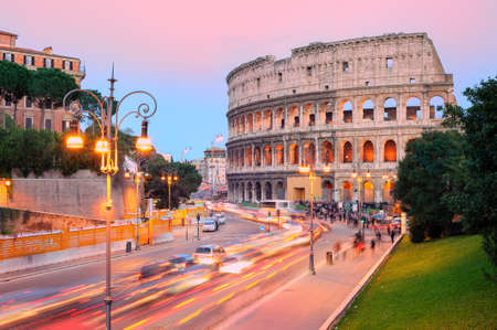 modern building: The ruins of Colosseum in the city center of Rome, Italy, on sunset