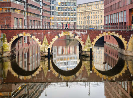 water town: Bridge reflecting in water in the old town of Hamburg city, Germany Stock Photo