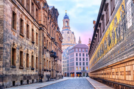 princes street: Old town of Dresden with Furstenzug (Procession of Princes) mural wall and Frauenkirche (Church of our Lady) cathedral in the early morning light Stock Photo