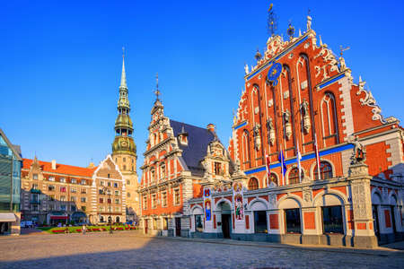 old town house: City Hall Square with House of the Blackheads and Saint Peter church in Old Town of Riga in sunset light, Latvia