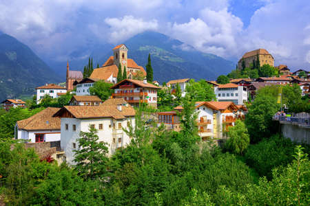 meran: Panoramic view of the alpine village Schenna by Merano in South Tyrol, Italy, with Marias Church and the Castle