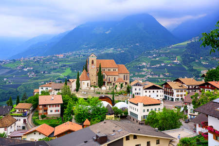 meran: Traditional alpine village with wooden houses and red tiled roofs Schenna by Merano in South Tyrol, Italy Stock Photo