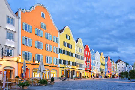 upper austria: Colorful traditional houses in gothic old town Scharding, Upper Austria, in the evening Stock Photo