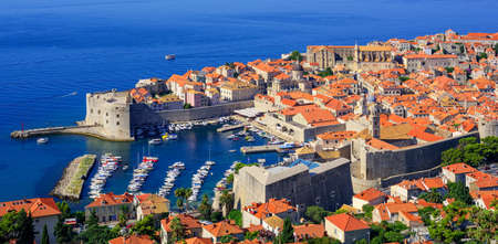 center city: Red tile roofs and walls of the historical old town port of Dubrovnik, Croatia