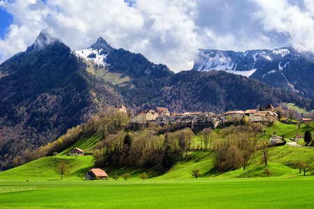 Gruyeres town, known for his world famous Gruyere cheese, laying on a hill in the Alps mountains, Switzerland