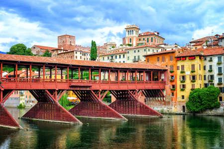 grappa: Famous wooden bridge Ponte degli Alpini over river Brenta in Bassano del Grappa, a little town in Veneto, Italy Editorial