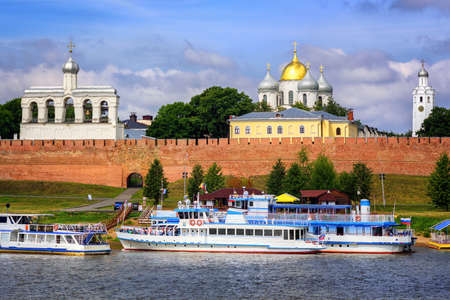russian: Novgorod Kremlin with red brick walls and white churches with golden and silver domes, Russia Stock Photo