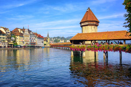 water town: Wooden Chapel Bridge over Reuss river and Water Tower is an iconic sight in the old town of Lucerne, Switzerland