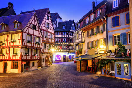 Traditional half-timbered houses in the old town of Colmar decorated for christmas, Alsace, France Stock Photo