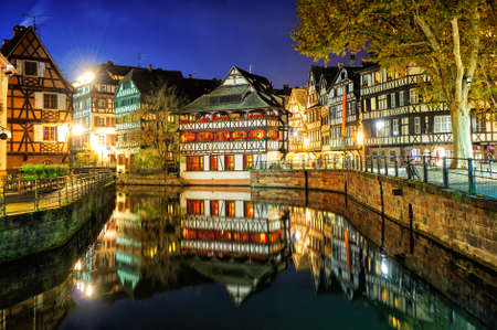 Traditional half-timbered houses in La Petite France, Strasbourg, Alsace, France, at night