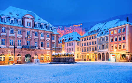 Medieval german old town Heidelberg white with snow in winter, Germany Standard-Bild
