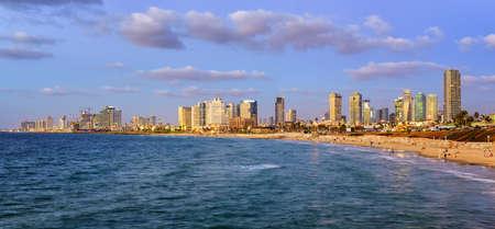 Modern skyline and sand beaches of Tel Aviv city on sunset, Israel Stock fotó