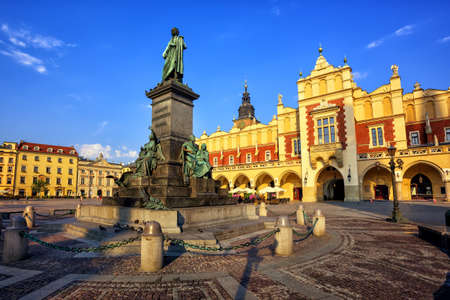 Adam Mickiewicz Monument in fron of Cloth Hall in Krakow is a favourite meeting place at the Main Market Square in the Old Town (Stare Miasto) of Krakow, Poland