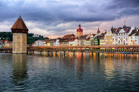 water town: Chapel Bridge and Water town in the old town of Lucerne on dramatic sunset, Switzerland