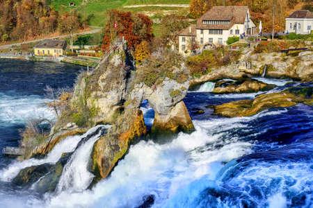 The Rhine Falls near Schaffhausen, Switzerland, is the largest waterfall in Europe Stock Photo