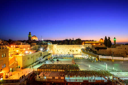 The Western Wall and Temple Mount with Golden Dome of the Rock and al-Aqsa Mosque in the old town of Jerusalem, Israel, on sunrise