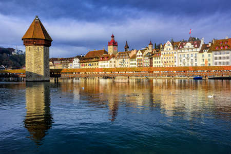 water town: Old town of Lucerne with Chapel Bridge and Water Tower reflecting in Reuss river, Switzerland Editorial