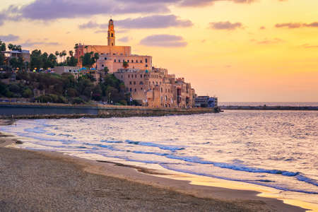 yaffo: Old town of Jaffa over the sand beach bay on sunset, Tel Aviv, Israel