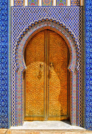 The golden doors and ornamented colorful tiles of Dar el Makhzen, Royal Palace in Fes, Morocco