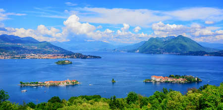 Panoramic view of Lago Maggiore lake, three Borromean islands (Isola Bella, Superiore, Madre) and Alps mountains, Italy, Switzerland
