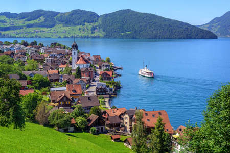 Cruise ship arriving in small town Beckenried on Lake Lucerne, swiss Alps mountains, Switzerland Stock Photo - 88654239