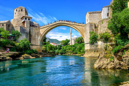 Historical Stari Most (Old Bridge) and Koski Mehmed Mosque in the Old Town Mostar on Neretva River, Bosnia and Herzegovina