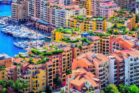 Colorful apartment buildings and yacht port in the city center of Monaco, Europe