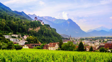 Vaduz town, panoramic view of the capital of Liechtenstein with the Castle Vaduz, Alps mountains, Europe