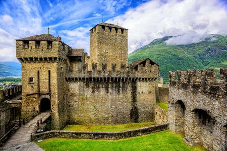 Medieval stone castel Castello di Montebello with defensive walls and towers in swiss Alps mountains, Bellinzona, Switzerland