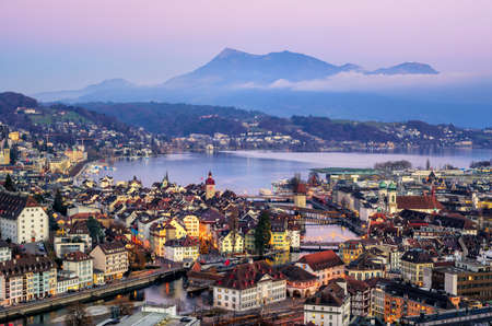 Aerial view of the Old Town of Lucerne, wooden Chapel bridge, stone Water tower, Reuss river, Rigi mountain and Lake Lucerne, Switzerland, on sunset