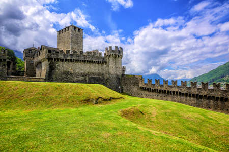 Medieval stone castel Castello di Montebello with defensive walls and towers in swiss Alps mountains, Bellinzona, Switzerland