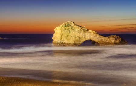 The Pierced Rock (Rocher Perce) on Miramar beach in Biarritz, France, on sunset