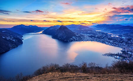 Dramatic sunset over Lake Lugano in swiss Alps, Ticino, Switzerland