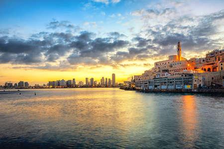 Jaffa Old Town and modern Tel Aviv skyline on dramatic sunrise, Israel