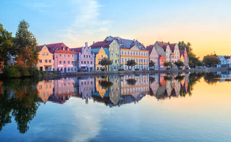 Landshut Old Town, Bavaria, Germany, traditional colorful gothic houses reflecting in Isar river on sunrise
