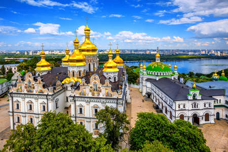Kiev, Ukraine, golden domes of christian orthodox Dormition cathedral in Kyiv Monastery of the Caves or Kiev Pechersk Lavra on Dniepr river