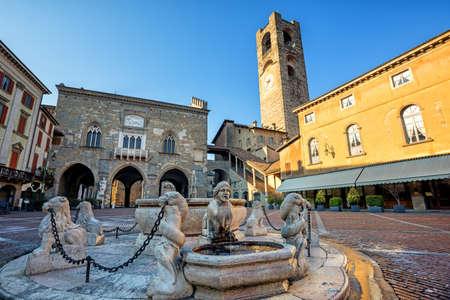 Piazza Vecchia in Bergamo Old town, Italy, with Contarini fountain, Palazzo della Ragione, Palazzo del Podesta and Campanone tower