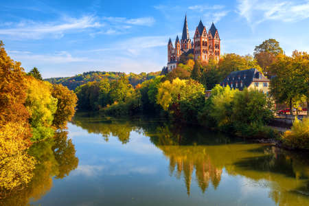 Limburg an der Lahn town, Germany, view of the cathedral reflecting in Lahn river in autumn