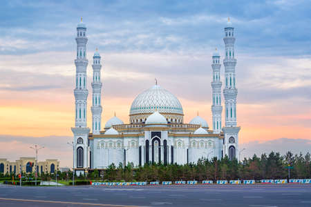 Astana, Kasakhstan, beautiful white Hazrat Sultan mosque, the largest mosque in Central Asia, in dramatical sunset light