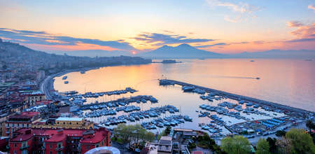 Panoramic view of Naples city, Italy, with Gulf of Napoli and Mount Vesuvius volcano, at sunrise