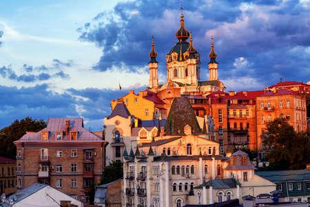 Kiev, Ukraine, view of St Andrews Church on historical Andrews Descent street in dramatical sunset light