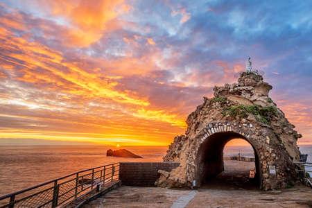 Biarritz, France, Rock of the Virgin (Rocher de la Vierge) on dramatical sunset over Atlantic ocean