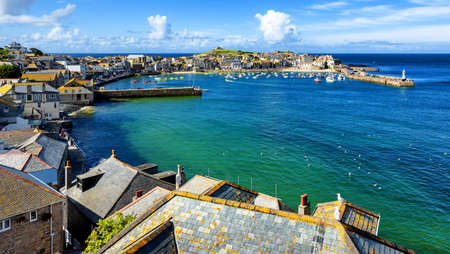 St Ives, view over the roofs and lagoon to the port and old town, Cornwall, England, United Kingdom