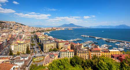 Panoramic view of Naples city, Chiaia neighborhood, Mount Vesuvius and gulf of Napoli, Mediterranean sea, Italy