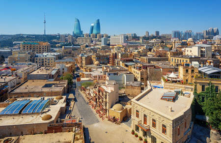 Baku city, aerial view over the Old town and modern skyline with iconic Flame Towers building, Azerbaijan 版權商用圖片